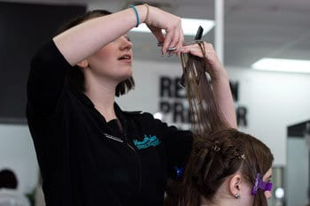 Kenneth Shuler students cutting hair