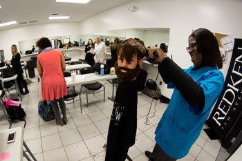 Students learning cosmetology in classroom