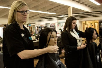 Spartanburg students practicing hair cuts and styling