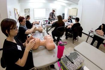 Esthetics students practicing on mannequins